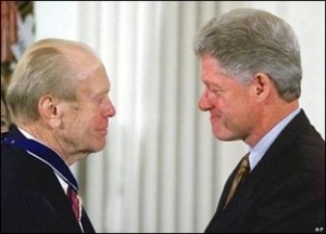Photo of Presidents Clinton and Ford looking at each other