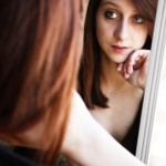 Picture of Woman Looking In Mirror